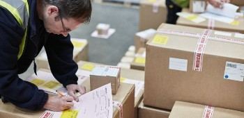 Customs agent checking shipping documents